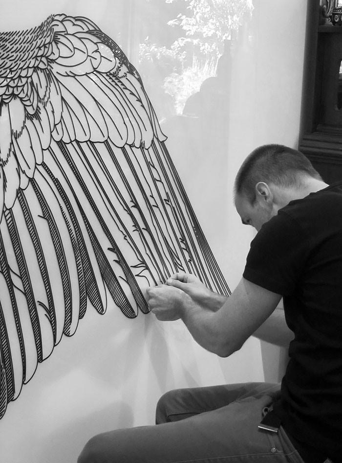 Australian street artist Buff Diss أشرطة لاصقة بدل الدهان على الحوائط