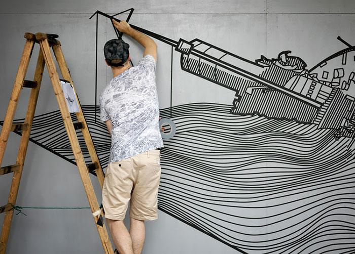tape-street-art-buffdiss أشرطة لاصقة بدل الدهان على الحوائط